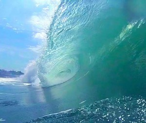 The wave starts to curl over and form a barrel
